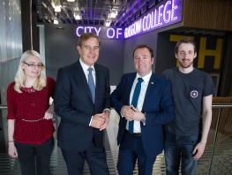 Exchange Communications Managing Director Tom Sime and City of Glasgow College Corporate Development and Innovation Director Roy Gardner with technical support students Laura Bulloch and Daniel Kearney