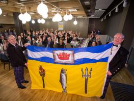 LtoR: Principal Paul Little and Rt. Hon. Lord Lyon with the College's Official Flag