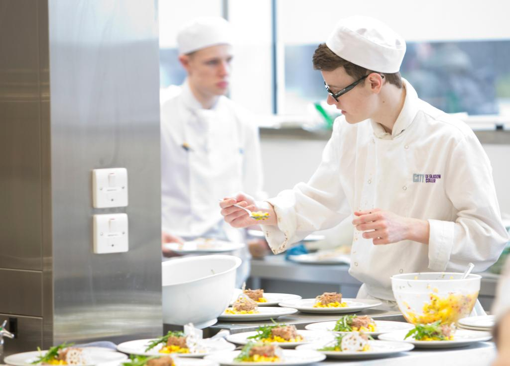 Professional Cookery students working in the kitchens at City campus.