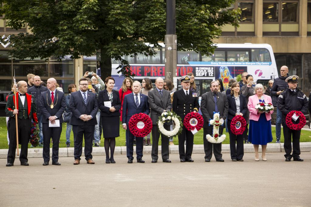 Dignitaries prepare to lay wreaths for Merchant Navy Day
