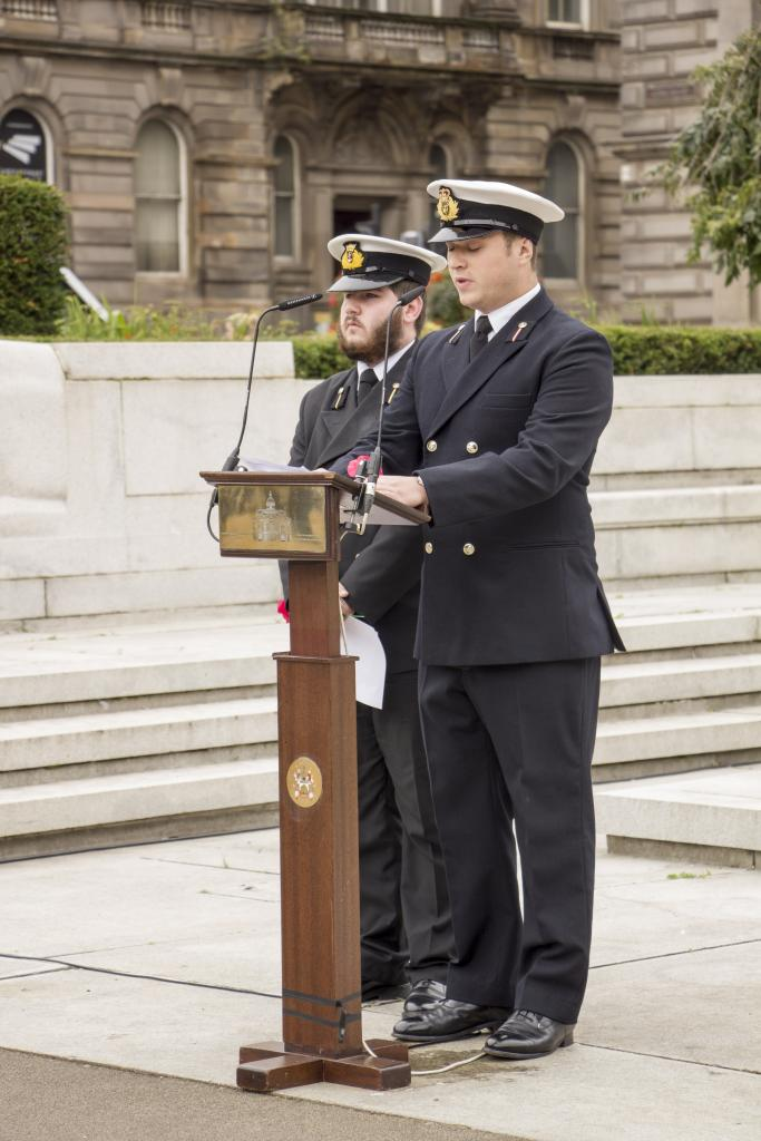 Cadet, Adam Stockman, and Cadet, Angus Treadwell read from the Roll of Honour