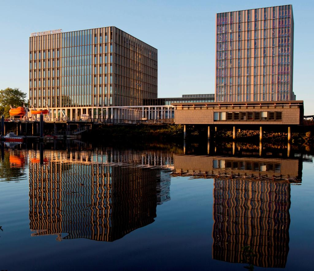 External photo of Riverside campus showing marine skills centre sitting over the River Clyde