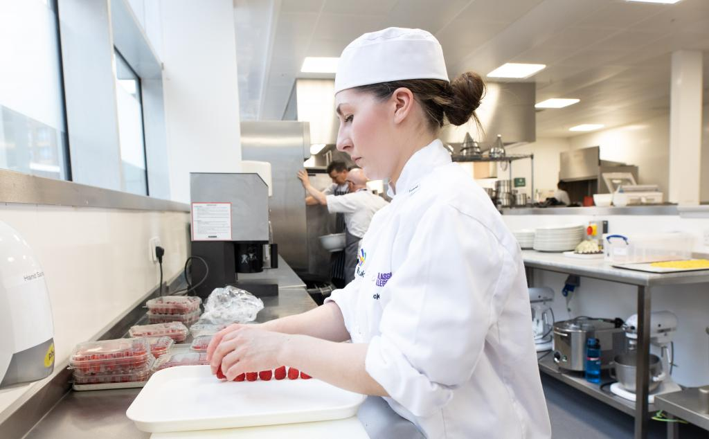 Professional cookery student at work in kitchens in City campus
