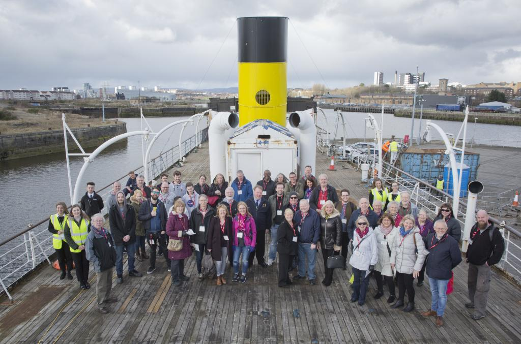 Tour group aboard TS Queen Mary for anniversary weekend tour