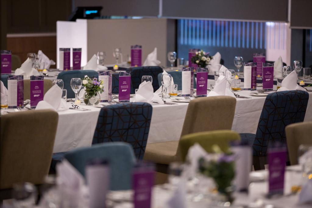 Tables set up for an event at City of Glasgow College.