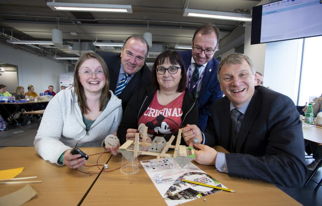 Gerry Facenna, Roy Gardner, Ivan McKee with teachers from Thorntree Primary School