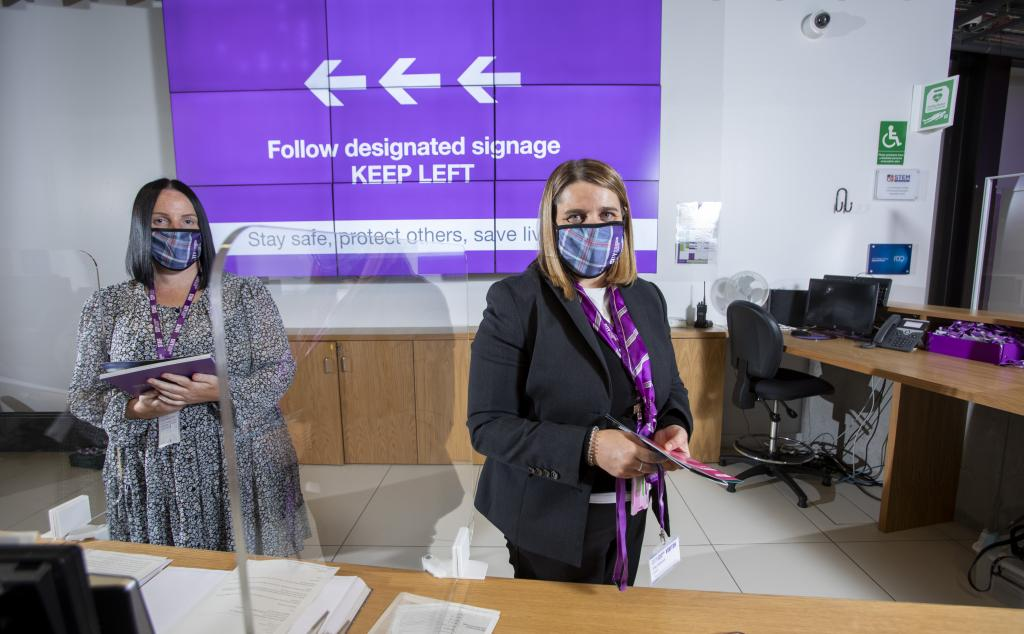 Photograph of reception staff wearing staff face masks