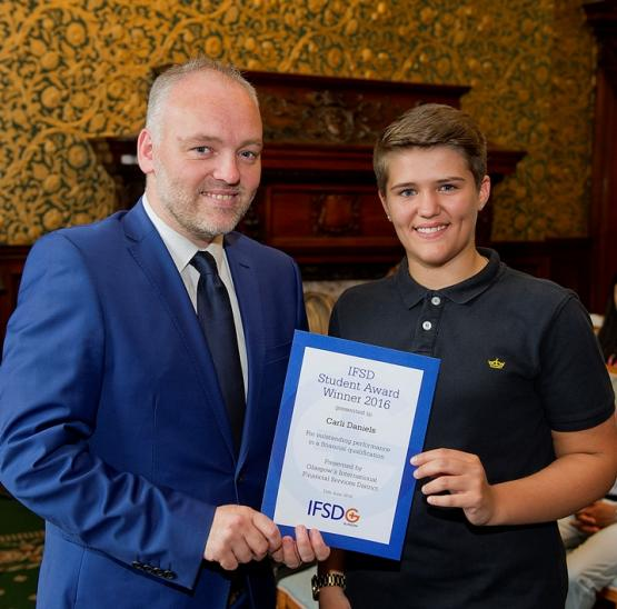 Carli Daniels is presented with her 2016 IFSD Glasgow Student Award by Kevin Rush, Head of Economic Development, Glasgow City Council