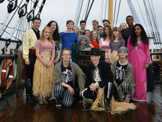 Students pictured in costume aboard the Tall Ship