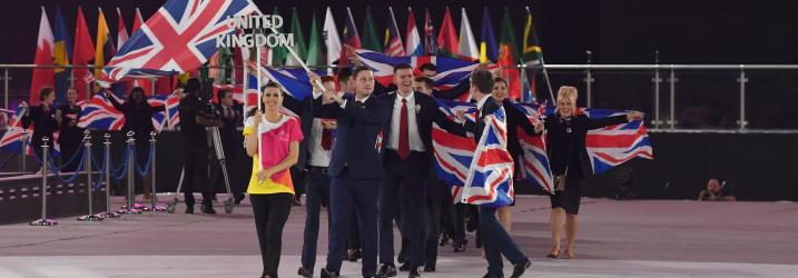 Group of people holding the British flag