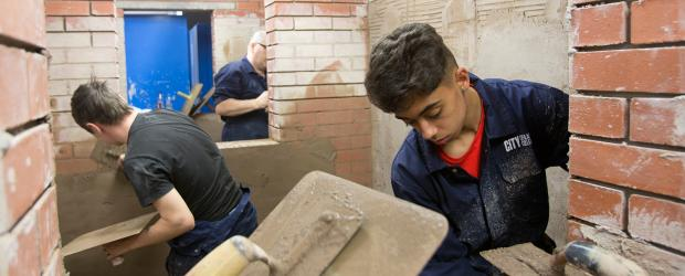 Students dealing with brickwork