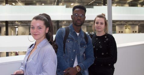 Students in atrium at City campus.