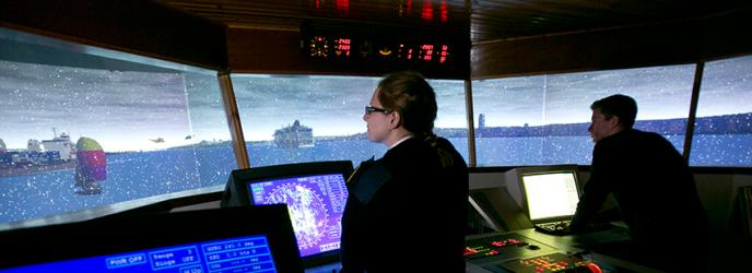 Students operating ships simulator