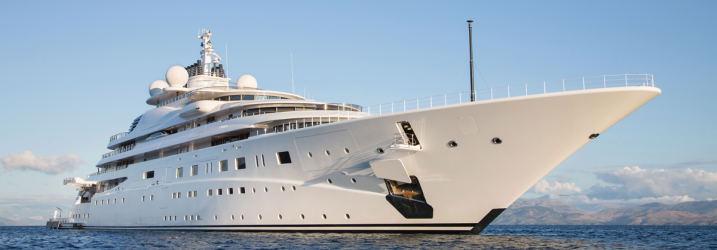 Superyacht sailing on the ocean.