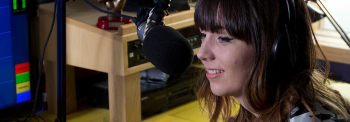Student recording in the radio studio