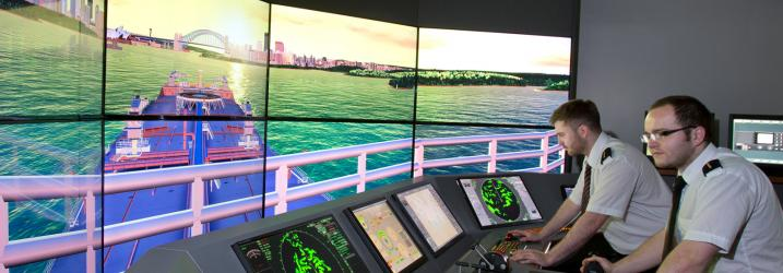 Students practicing on one of the shipping simulators at Riverside campus