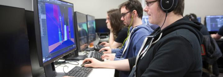 Students working on a computer in an IT lab.