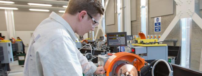 Engineering student at machinery.