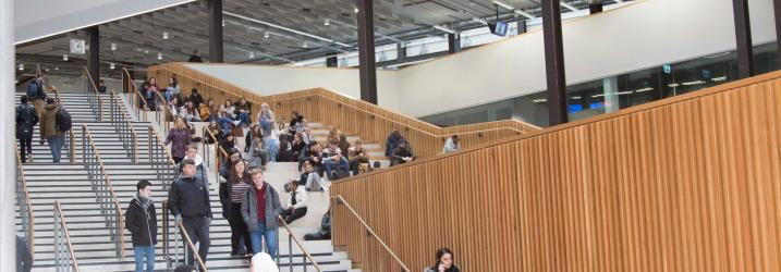 Students in atrium at City campus.
